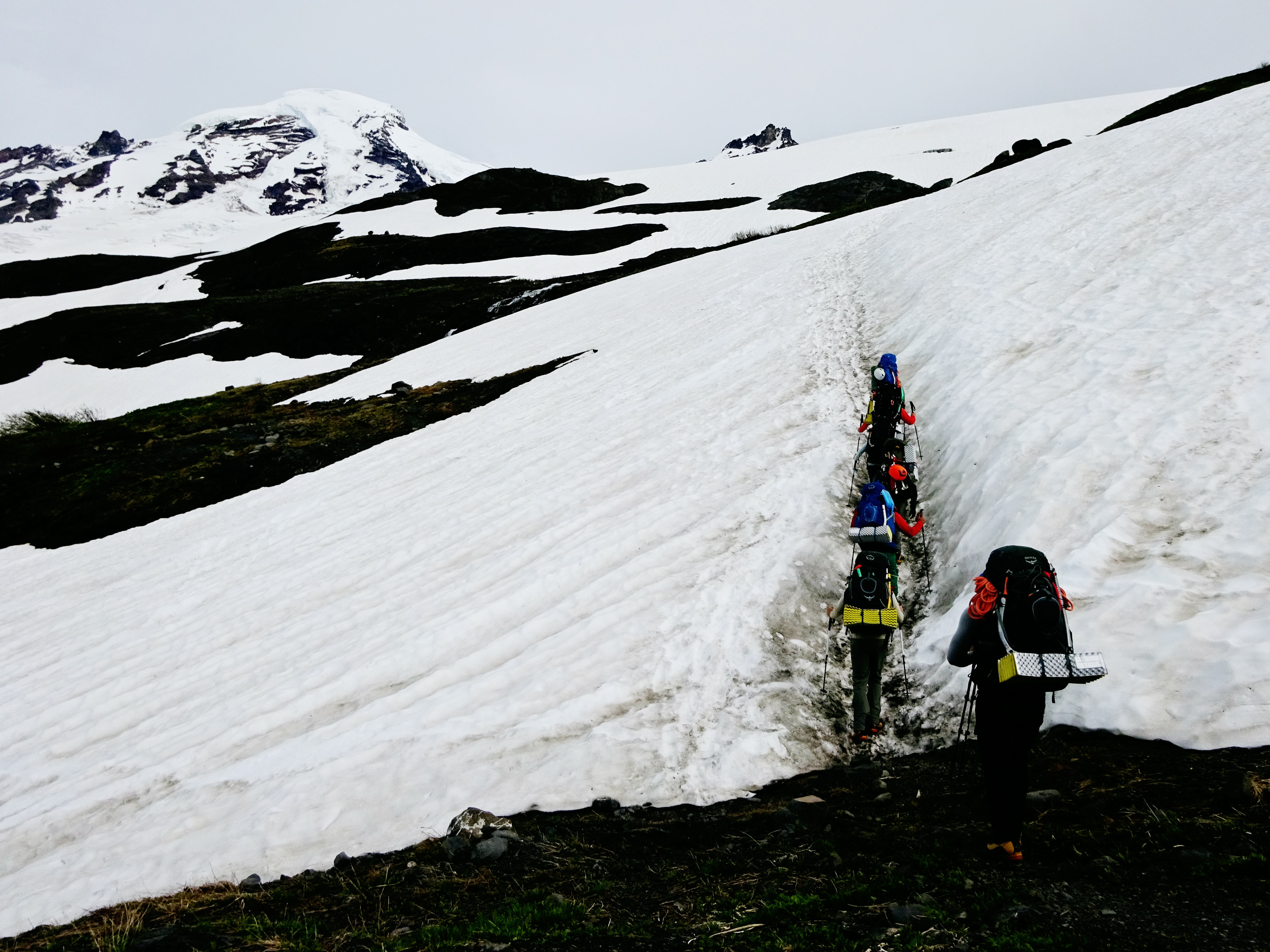 Stepping onto the first snowfield while hiking up to base camp on Mt Baker